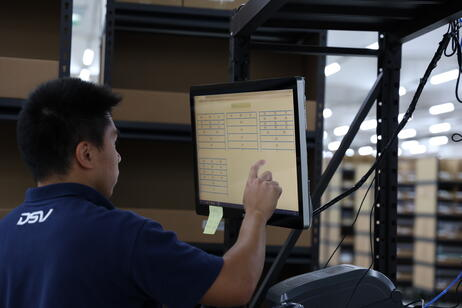 worker at a picking station using Geek+ tech
